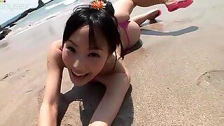 Svelte brunette babe Yuri Hamada on the beach looking cute