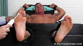 Older perv tormenting tattooed hunk by tickling him all over body