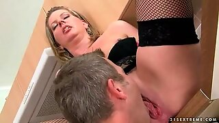 Grandma gives blowjob and gets fucked in kitchen