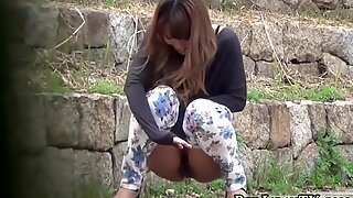 Asian babes squat to pee