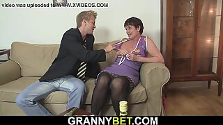 Old granny in stockings takes it on the couch